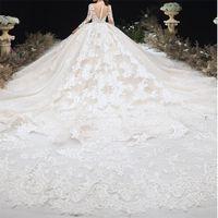 Vestido de bola de lujo Dubai Bola Vestidos de novia Mangas largas Encaje Apliques Vestidos nupciales Elegante Arabian Custom Hecho Vestidos De Novia