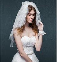 Velo nupcial de perla pegajosa de seis capas para la fiesta de bodas Accesorios de velos cortos con peine de alta calidad