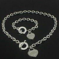Горячие продажи рождения рождественский подарок 925 серебряное ожерелье в любви + браслет набор свадебные выступления ювелирные изделия сердца кулон ожерелье браслеты 2 в 1