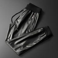 Thoshine Brand Uomo Pantaloni in pelle Pantaloni Superior Qualità Elastico Vita Pantaloni da jogger Pantaloni con cerniera Pantaloni maschili Pantaloni in ecopelle Slim Fit 201118