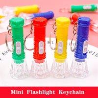 TRANSPARENT MINI lampe de poche électronique lumineuse lumineuse portable lampe de poche cadeaux personnalisés de petits cadeaux en gros