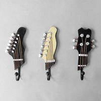 3pcs / Ensemble Crochets muraux en forme de guitare Vintage en forme de guitare Résine Instrument de musique Modèle Décore Crochet de porte pour Bar Chambre à coucher Accueil MX5081158