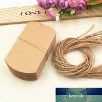 100pcs / lot Boîtes cadeaux de mariage Nouveau style Kraft oreiller forme de mariage de mariage box cadeau