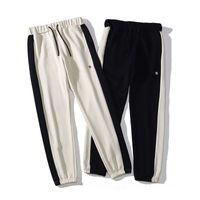 Designer Pants Mens Moda conissetto conissetto rilassato Homme Man Moda Vestiti di Lusso Stampato Lettere Black Black White Hip-hop Casual Sweatpants M-2XL