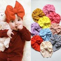 Gorras sombreros 30 unids / lote sólido seersucker bebé sombrero de bebé waffle tela gran arco gorros topknot turban bonenet sólidos sólidos cabezales para 0-5T kids1