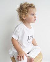 أزياء الصيف الأطفال تي شيرت أزياء الفتيات إلكتروني مطبوعة القطن تيز بنين قصيرة الأكمام عارضة قمم طفل فتاة الملابس A5365