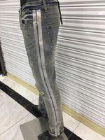 Hommes Jeans Designer Luxurys Denim Pants Strip Trous Slim-jambe Moto Bikerclcle Biker Pantalon Fashion Jean Top Qualité Taille américaine W29-W40