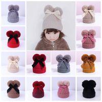 9styles Çift Kürk Topu Yay Şapkalar Bebek Pom Pom Beanie Kap Toddler Çocuklar Bebek Kız Kış Sıcak Tığ Örme Şapka Aksesuarları Kapaklar CYF4574