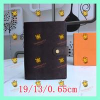 ноутбук Оптовая кожаный ноутбук и повестка дня Розничного мужской кожи Мода Досуг Дизайнер карманные женщины бумажник с мешком пыли Box