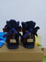أزياء المرأة الأطفال الطفل الأصلي الشريط الثلوج أحذية جديدة بقرة سبليت جلد طبيعي الكاحل أحذية أسود اللون زهرة نمط القوس الأحذية التمهيد