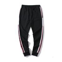 رجل عداء ببطء سروال GC جديد ووصفت الرباط الرياضة السراويل صيحات الموضة 4 ألوان الجانب الشريط مصمم p1DSUJ