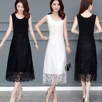 Fashion designer's sleeveless dress with large vest and lace dress in black white