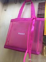 ¡NUEVO! Caja rosada clásica de compras Bolso de malla con cinta Estilo de moda Viaje Bolsa Playa Waste Wash Bag Cosmetic Maquillaje Malla de malla
