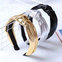 女性の弓の結び毛のフープバンドのための豪華なシンプルなPUレザートップノットワイドヘッドバンドヘアフープ女性のヘアバンド