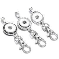 Cadena de joyería Cadenas de cuero de metal vintage de 18 mm Botón a presión Llavero Colgante para hombres Mujeres Anillos de llave
