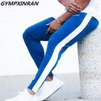 Gympxinran Nuevos hombres pantalones Hip Hop Fitness Ropa Joggers Sweetpants Stripe Stripe Classic Fashion Streetwear Pantalones Pantalones Pantalones Y200114