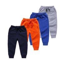 2020 ربيع جديد وصول ملابس الطفل الأطفال السراويل الطويلة الأزياء نقية اللون القطن جيوب الرياضة الصبي السراويل الاطفال طماق LJ201127