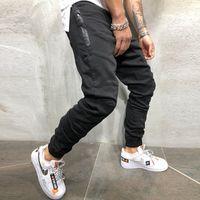 Gympxinran hombres pantalones de moda empalme multi bolsillo harem joggers pantalones pantalones masculinos joggers joggers sólidos pantalones Sweypants Y200114