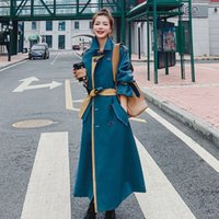 Fashionable and elegant long windbreaker women's new autumn and winter thickened temperament fake two pieces of color contrast foreign style