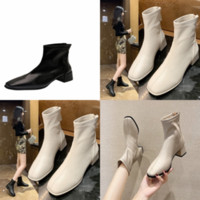 DJY العلامة التجارية الجوارب الأزياء والأحذية في العاصفة كوير الأحذية القضاوات النساء منتصف العجل سيدة التمهيد فاخر جديد