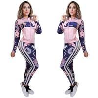 Женские активные трексуиты модные цветы узор с нарядами полосой наряда 2020 Осенняя куртка леггинсы для оптовых модных 2 штуки наборы