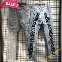 Pantalones de bordado con letra verde fluorescente negro Hombres Mujeres Hip Hop Daño Agujero Jeans envejecido Jeans de alta calidad Jean