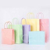 Bolsos Candy Color Sólido Bolso de regalo Compras Ropa de envío Bolsa de envolver de caramelo útil Papel Bolsa de papel con mango S M L Zyy174