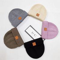 Unisex Kasketleri Kış Örme Şapka Trendy Kafatası Kapaklar Klasik Etiket Tığ Şapka Toque Örgü Kap Spor Sıcak Kulak Muff Beanie Ins