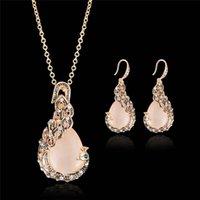 Pendientes Collar Retro europeo Juego de joyas para mujeres Cristal étnico Gema Peacock Charms Gold Cadena Sistemas de boda D24