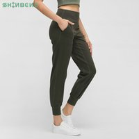 Shinbene Neaked-The Seep Tabric Fit Fit Sport Train Wagerers Женщины Масло мягкий эластичный тренировочный спортзал пробежки с двумя боковыми карманами Z1125