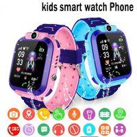 Q12 الأطفال الذكية ووتش sos الهاتف ووتش smartwatch للأطفال مع بطاقة سيم صورة للماء IP67 أطفال هدية ل ios الروبوت
