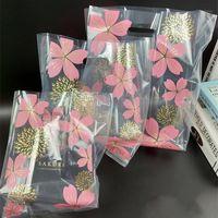 50 шт. Розовые вишни Цветы пластиковые подарочные сумки для хранения Ткань хранения Сумка Рождественская свадьба подарок подарок десертная упаковка1