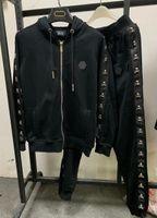 Almanya Moda Lüks Tasarımcı erkek Eşofman Metal Kafatası Kış Eşofman Sudaderas Hombre Takım Elbise Erkekler Track Suits Setleri Ceket + Pantolon 8549