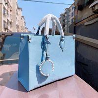 2021 분위기 스타일 럭셔리 패션 토트 백 여성 미니 고품질 관광 거리 디자인 가방 하이 엔드 1