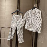Diseñador Ropa para mujer2021SS Impresión de la industria pesada Frente guapo Brazo Atrás Pasada larga de manga larga Denim Chaqueta Pantalones Traje
