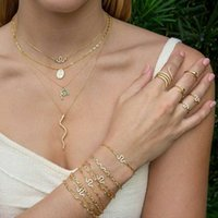 Золотая змея ожерелье для женщин Серебряное змеемое Слоистое ожерелье изюминки изюминки Серьги-змеи Браслеты Ювелирные изделия Грузные наборы Кристаллические Серьги