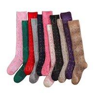 Chaussettes de mode filles Tube longue tube rétro glitter lettre de couleur coton confortable et résistant aux vêtements de sport chaussettes de sport