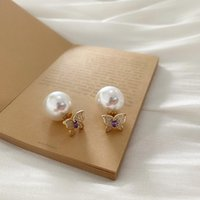 Goujon design coréen bijoux de mode simple papillon cuivre incrusté zircon zircon blanc rond blanc élégant boucles d'oreilles