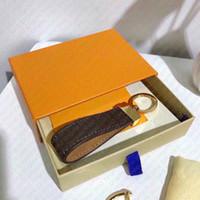 M65221 Dragonne Key Holder Designer Floral Canvas Keychain Car Key Catena Porta Anello Sacchetto Charm Pochette Accessori ID Nome Tag Timbro di stampaggio a caldo