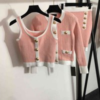 women sets BalM new three-piece knitted suit gold buckle hit color round neck long-sleeved cardigan+camisole+high waist short skirt