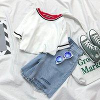 2021 Moda de verano Moda coreana Chándal para mujer Chica dulce camisa corta altura con agujero Pantalones cortos de mezclilla de cintura alta 2 piezas.