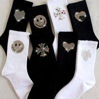 Socks Korean spring and autumn winter cotton socks shiny heavy industry Rhinestone smiling face black white pile middle tube stockings