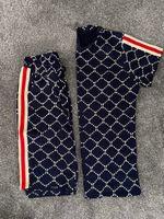 Hommes Fashion Summer Costudes Casual Tracksuits Modèle classique Modèle d'impression Men's Sleeve Shorts Hommes Tops Tops Boys Tees 4 Couleurs Vêtements