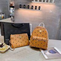 Neue Seitennieten Rucksack Mode Große Kapazität Reisetasche Handtasche. Sowohl Männer als auch Frauenschultaschen für Teenager-Girls-Luxus-Frauen-Handtaschen