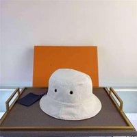 2021 디자이너 양동이 모자 여성 모자와 모자 패치 워크 워시 데님 솔리드 넓은 브림 코튼 태양 캐스쿼트 해변 양면 낚시 모자