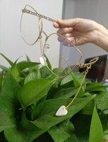 21SS 최신 패션 선글라스 여성 온라인 유명 인사 스타일 조정 가능한 체인 디자이너 큰 금속 프레임 사각 해변 태양 안경 상자