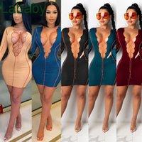 Femmes Robe Fashions 2021 Nouveau collier Bandage Jupe creuse Irregular Design Couleur Solide Femme Vêtements Robe de manche évasée