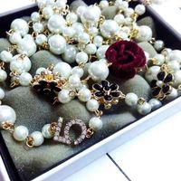 Vrouwen kleine geurige lange trui keten parel necklacependant gouden luxe bloem hanger ketting voor vrouwen