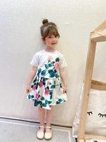 디자이너 소녀 장미 인쇄 된 복장 2021 여름 새로운 어린이 꽃 짧은 소매 티셔츠 + 주름 치마 2pcs 아이 의류 A6114