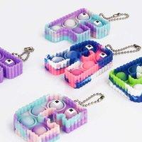 Empuje sus pops Fidget 5 * 6 * 1.5cm Tamaño Tamaño Toys Toys Multicolor Alphabet Llavero Llavero Popper Burbuja Finger Sensory Juguete para niños Regalos